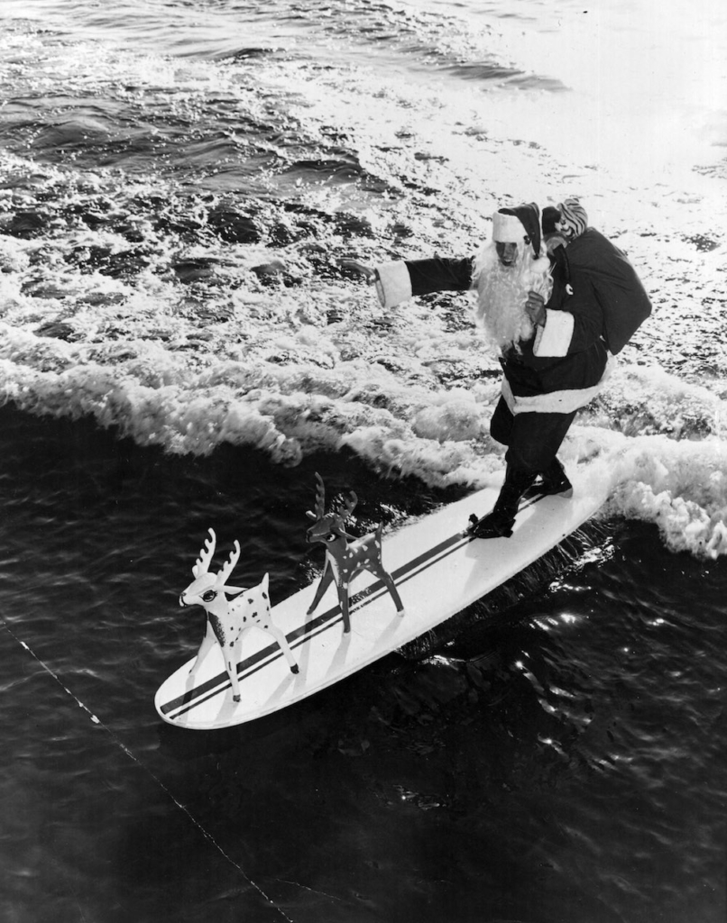 20th December 1968: Father Christmas arrives at Cypress Gardens, Florida, on his surfboard. (Photo by Alan Band/Fox Photos/Getty Images)