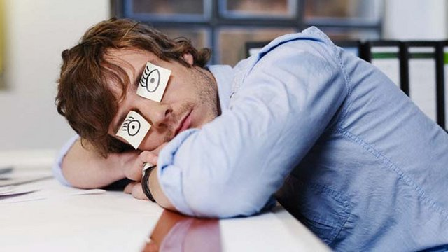 Young Man Sleeping with Drawn on Eyes --- Image by © Michael Haegele/Corbis