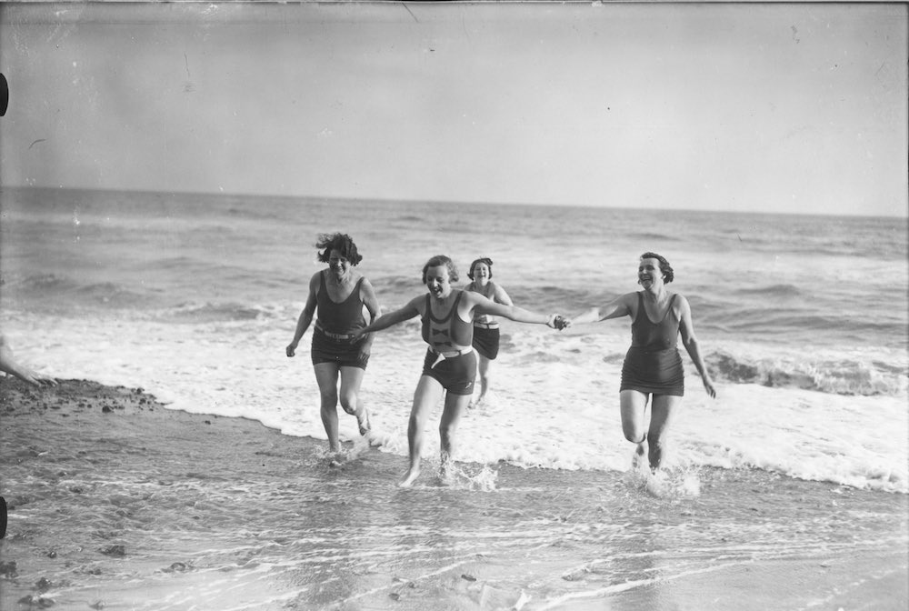 23rd December 1932: Visitors staying at the Branksome Towers Hotel in Bournemouth enjoying an unseasonable swim on a private beach at Christmas time. (Photo by J. A. Hampton/Topical Press Agency/Getty Images)