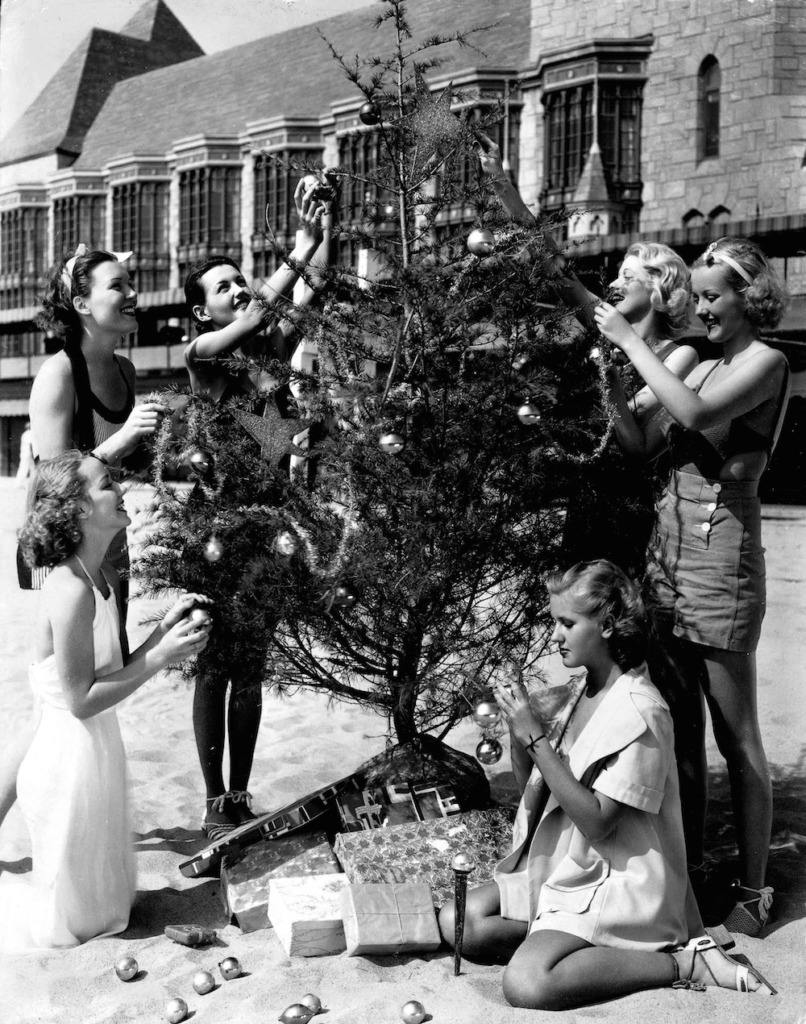 Volume 2, Page 109, Picture 8, A group of women decorating a christmas tree on the beach, circa 1950 (Photo by Popperfoto/Getty Images)